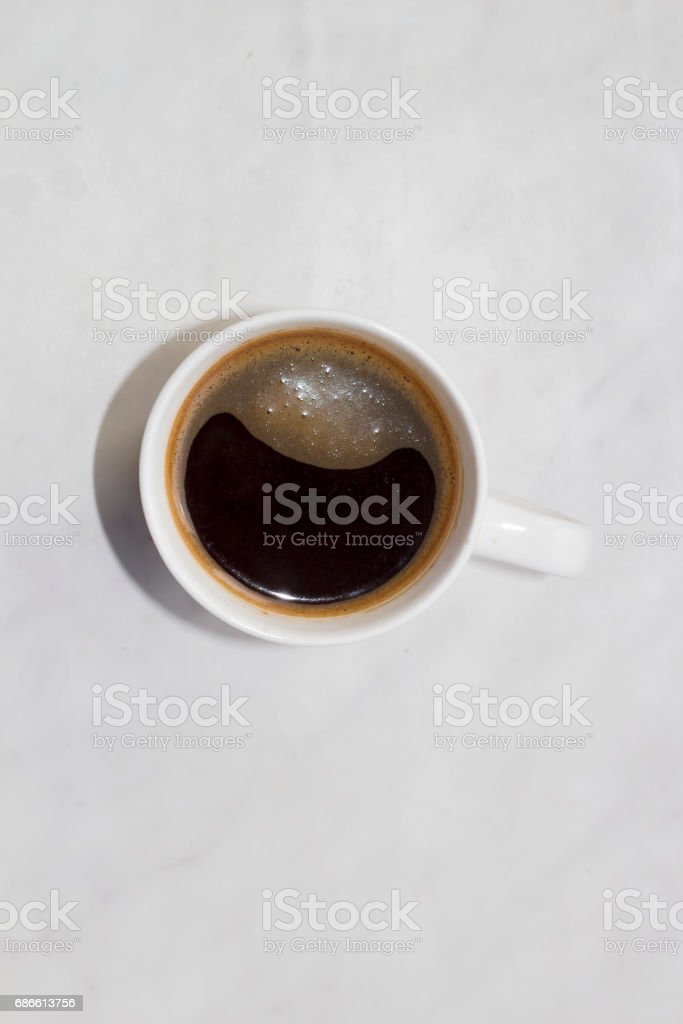 Cup of coffee on white background top view royalty-free stock photo