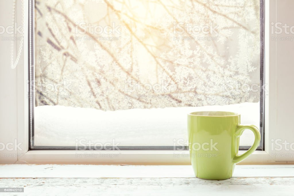 Cup of coffee on windowsill stock photo