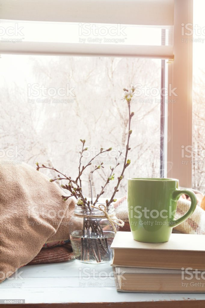 Cup of coffee on windowsill stock photo