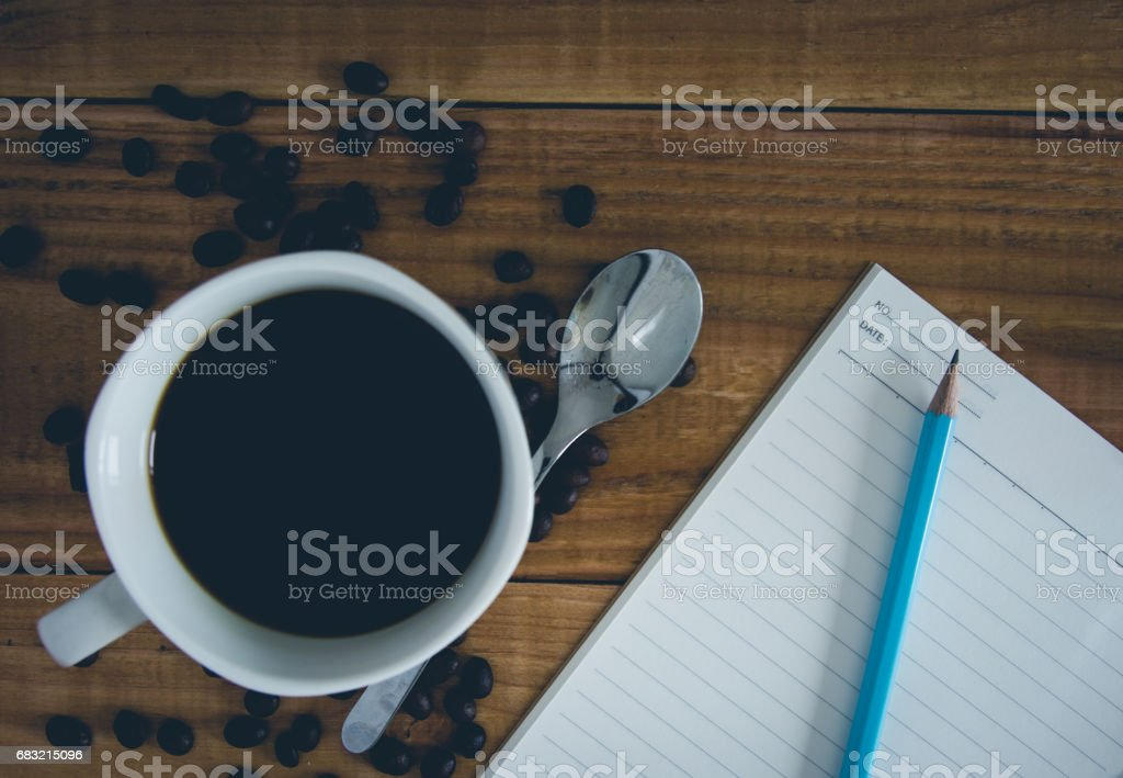 cup of coffee on wood background with book foto de stock royalty-free