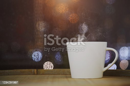 Cup of coffee on wood with bokeh background