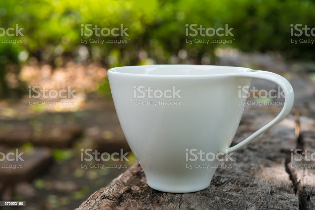 Cup of coffee on wooden background and copy space royalty-free stock photo