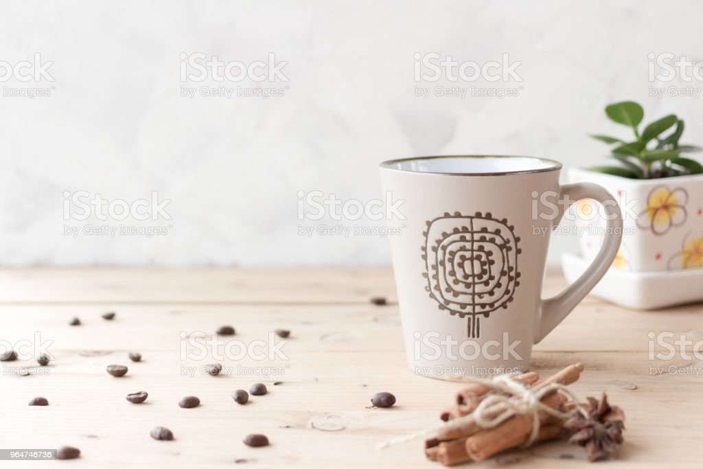 Cup of coffee on wooden table in the morning royalty-free stock photo