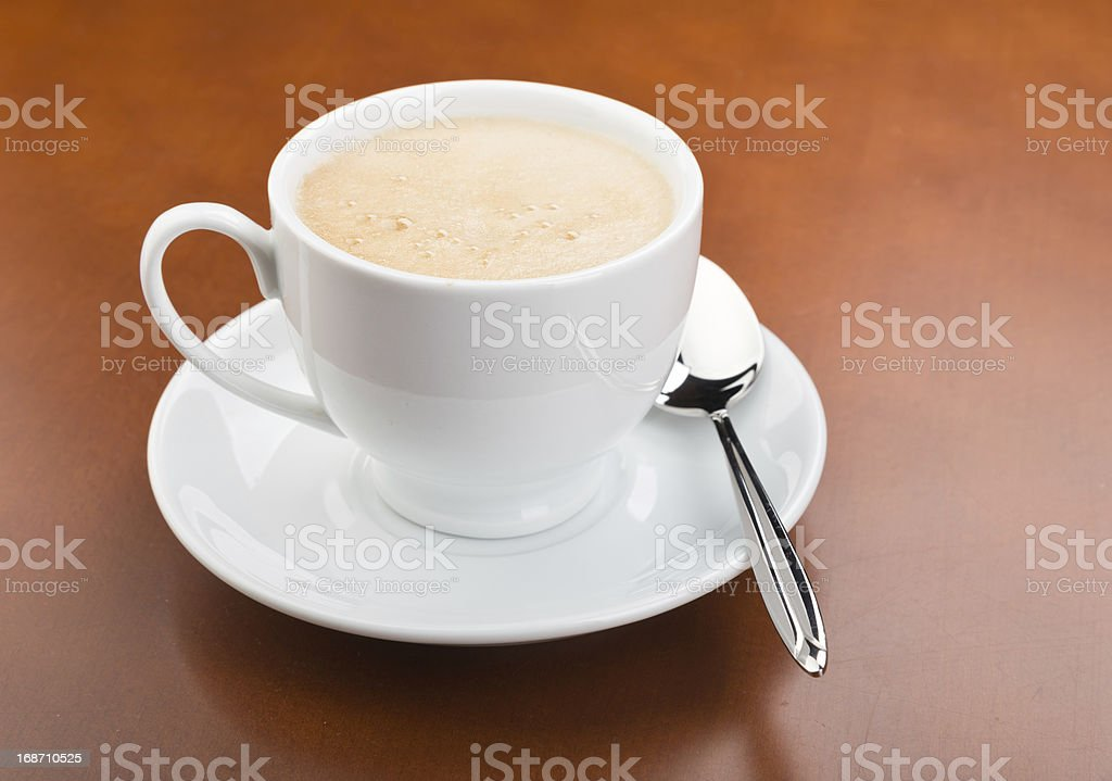 Cup of coffee on wooden table royalty-free stock photo