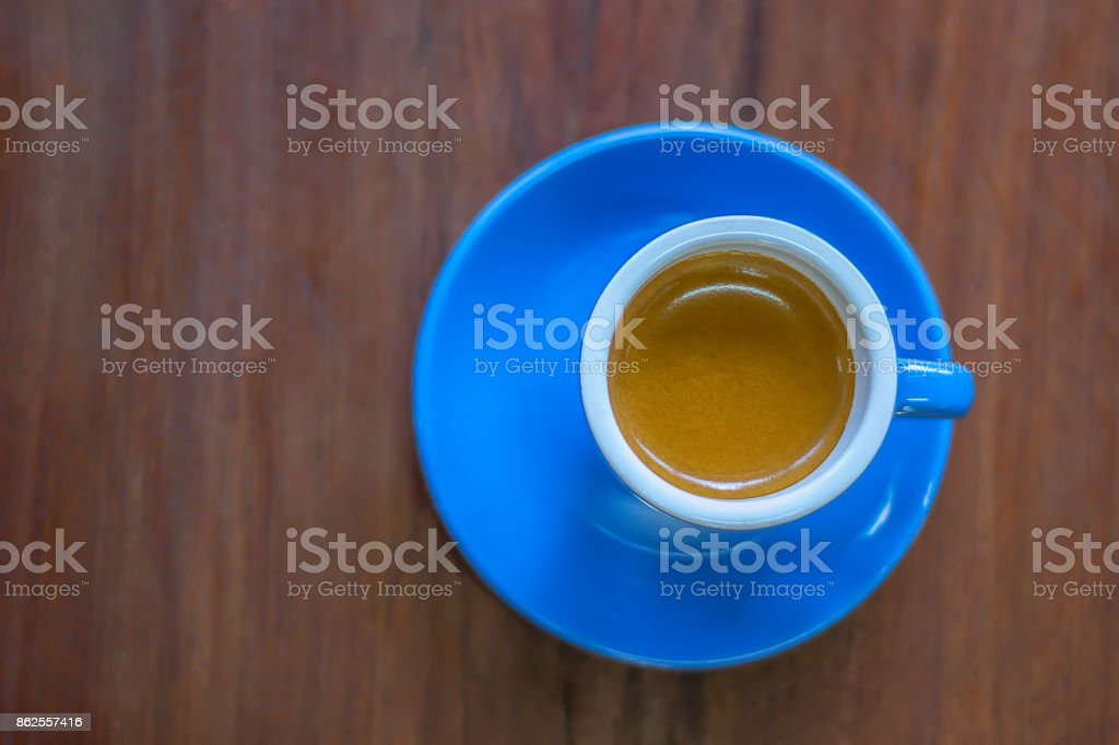 A cup of coffee on wooden table. stock photo