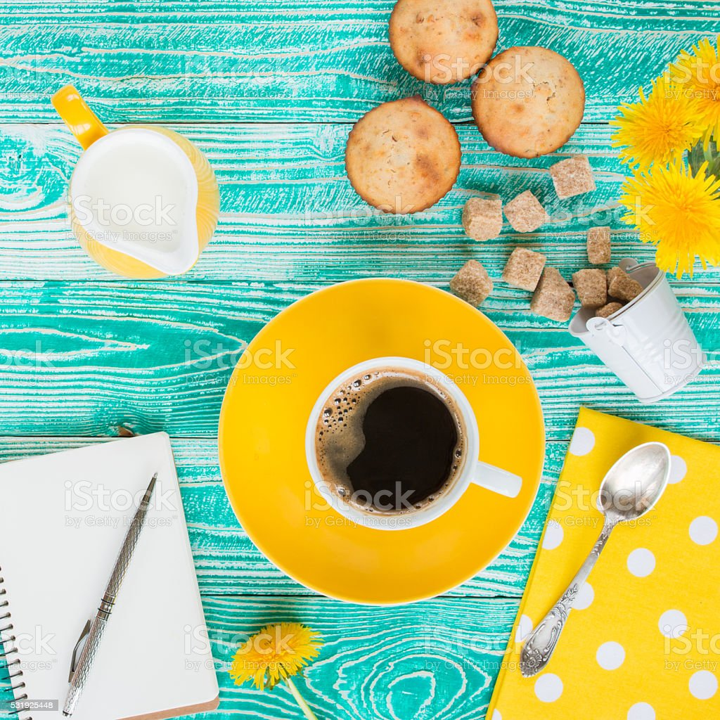 cup of coffee on yellow plate stock photo