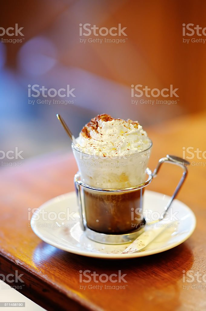 Cup of coffee or hot chocolate with whipped cream stock photo