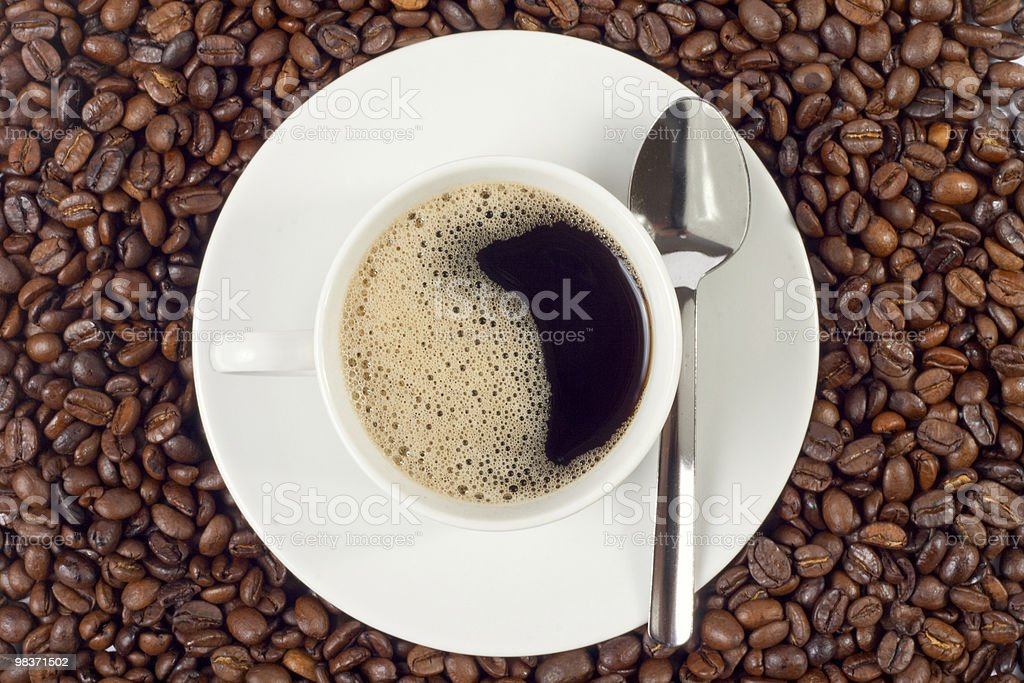 cup of coffee over beans royalty-free stock photo