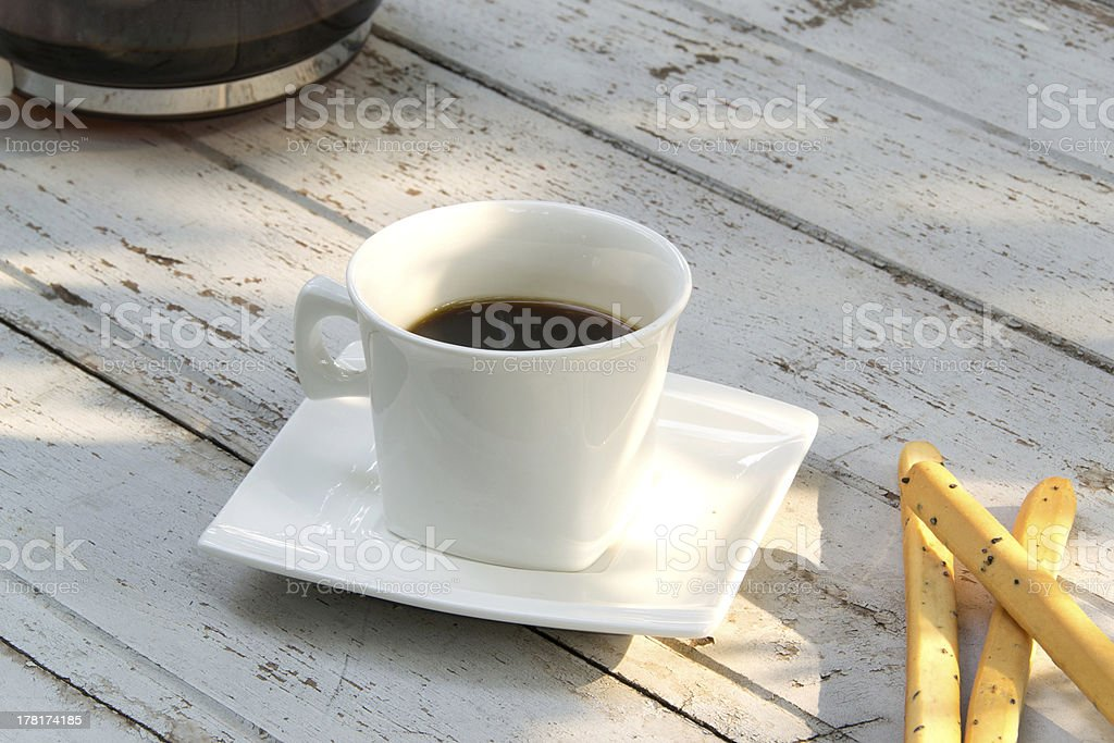 cup of coffee over grunge wooden background royalty-free stock photo