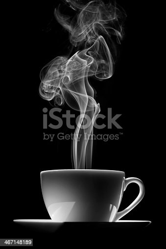 cup of coffee (or tea) with steam on black background