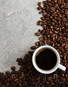 Cup of coffee and roasted coffee beans