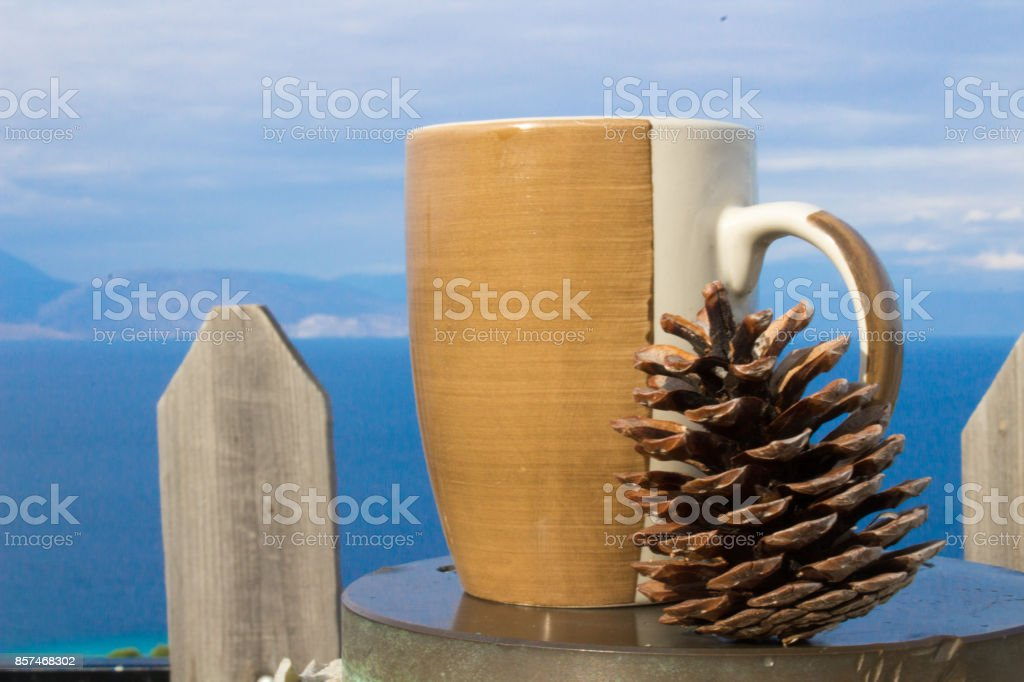 cup of coffee pine and sky at the background stock photo