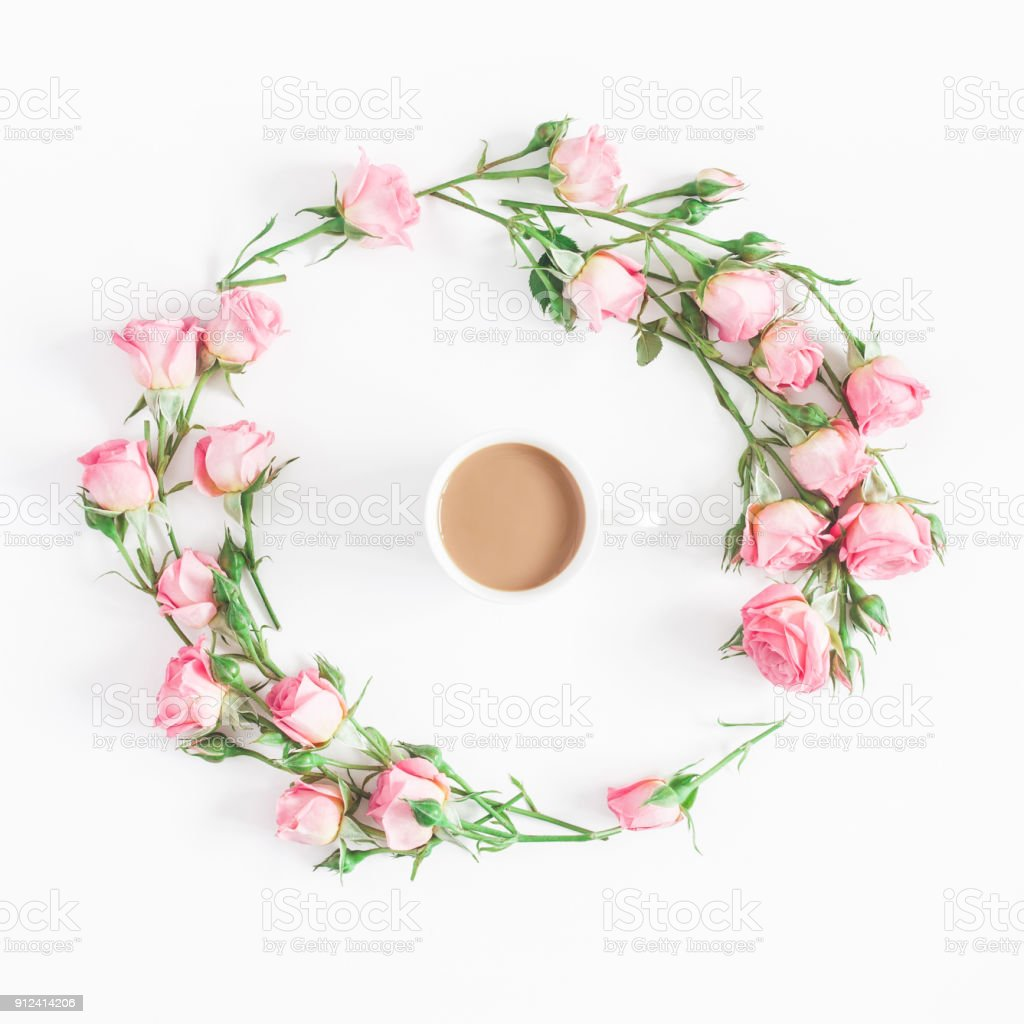 Flowers composition. Cup of coffee, pink rose flowers on white...