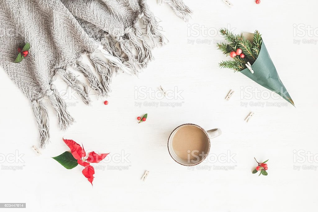 Cup of coffee, plaid, christmas poinsettia, bouquet of fir branches stock photo
