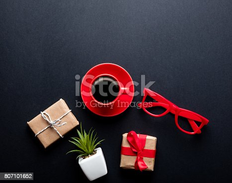 istock cup of coffee, plant, glasses and gifts 807101652