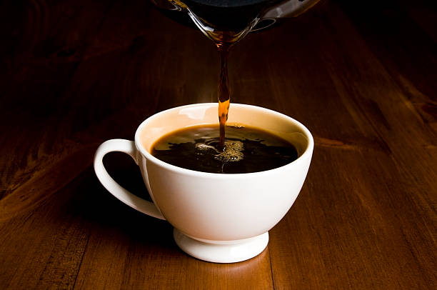 Cup of Coffee, Pouring stock photo