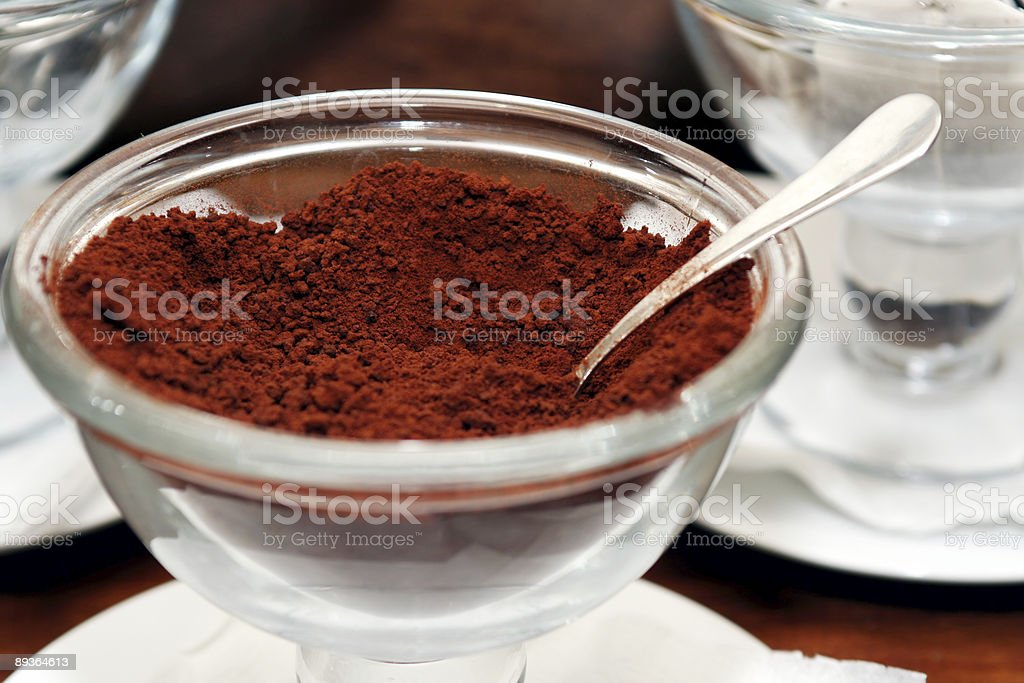 Cup of coffee powder with spoon royalty-free stock photo