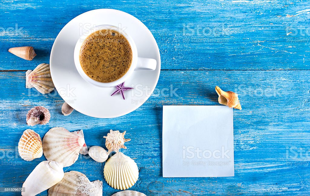 cup of coffee, shells, blue sticke stock photo