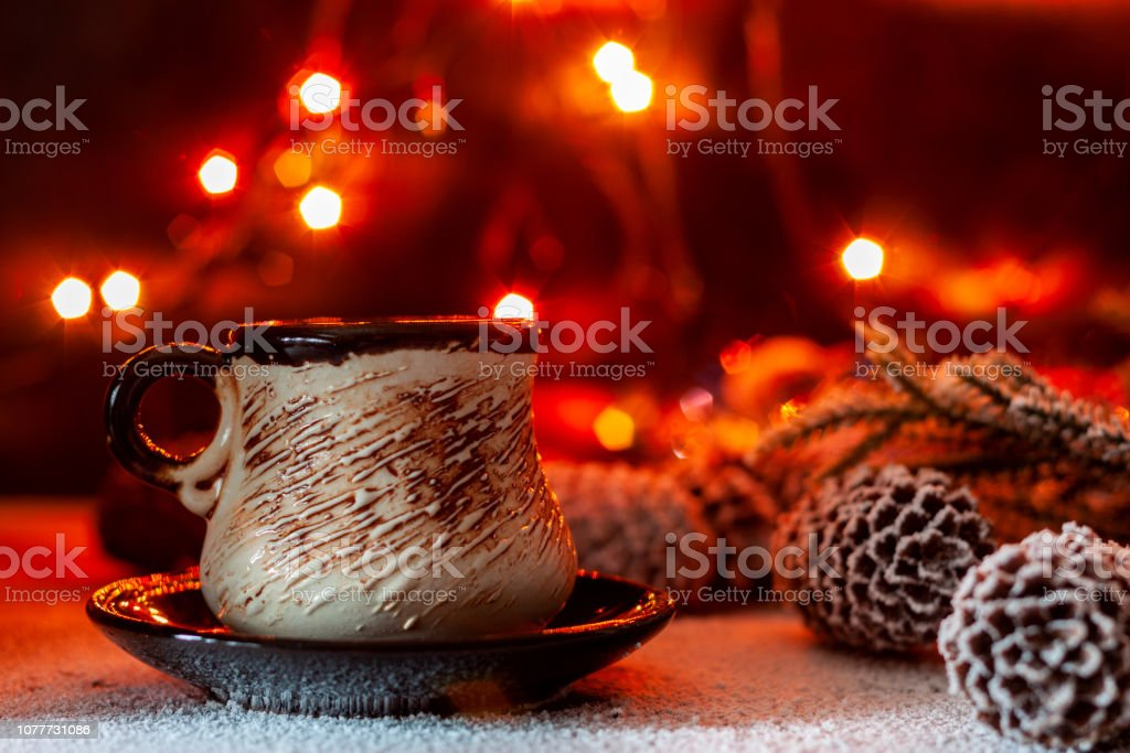 On the table is a cup of coffee on the background of New Year\'s...