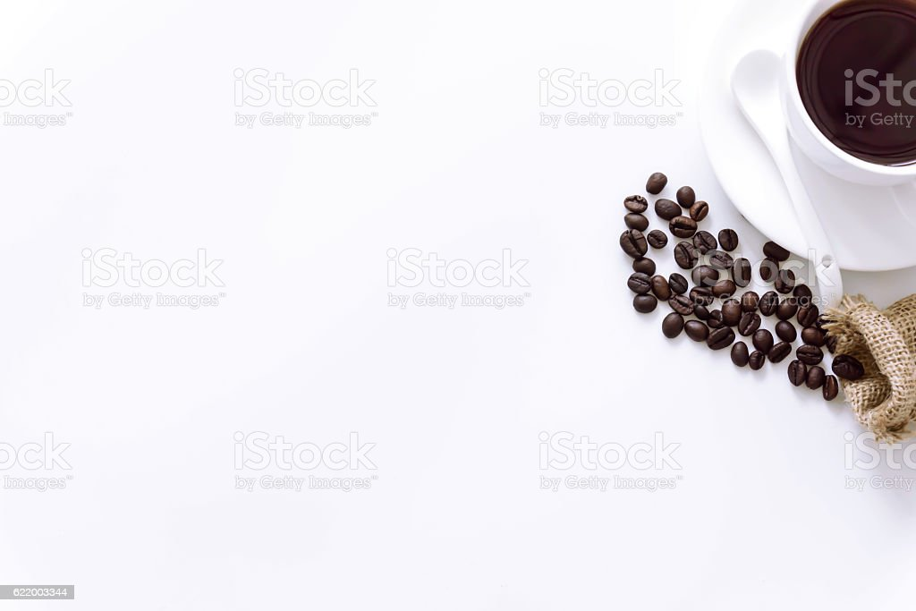 cup of coffee surrounded coffee beans on white background. stock photo