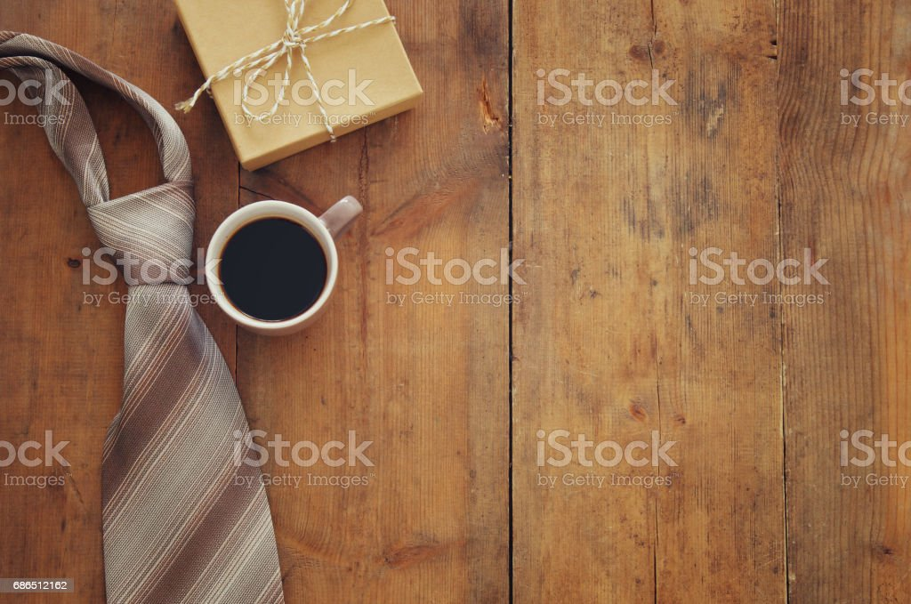 cup of coffee, tie and gift box. Father's day concept zbiór zdjęć royalty-free