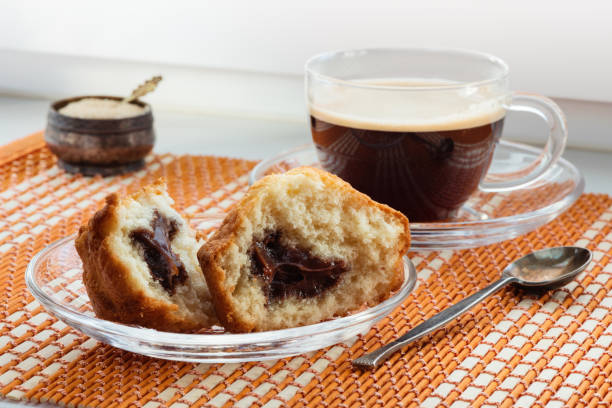 Cтоковое фото Cup of coffee, two halves  cake with stuffing and a