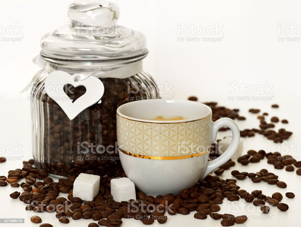 Cup of coffee, white heart, sugar and coffee beans
