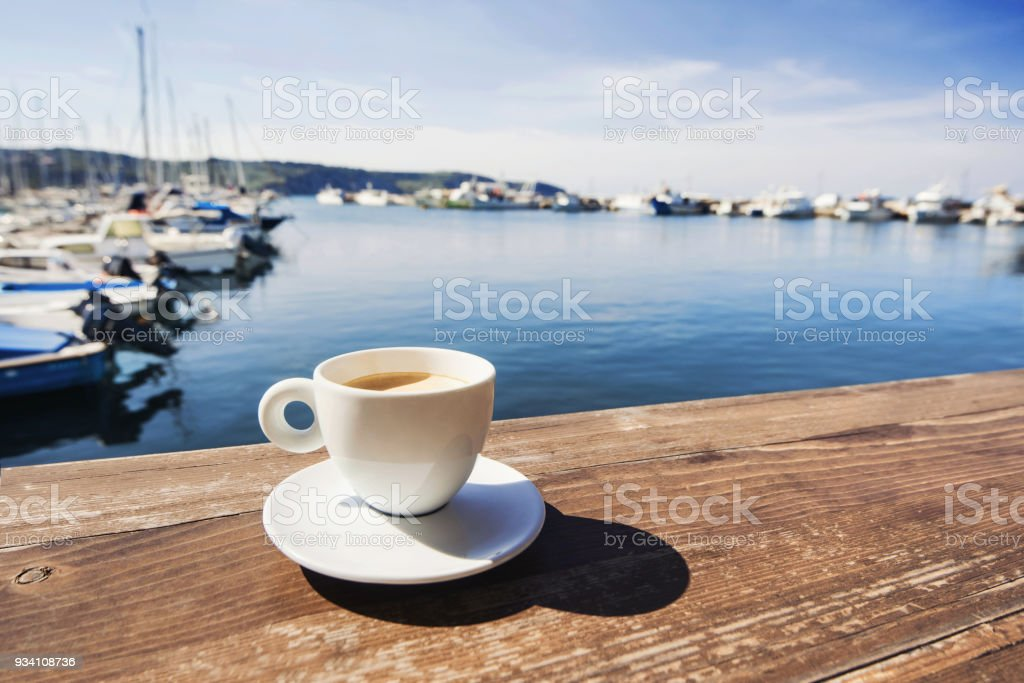 Cup of coffee with a sea at the background stock photo