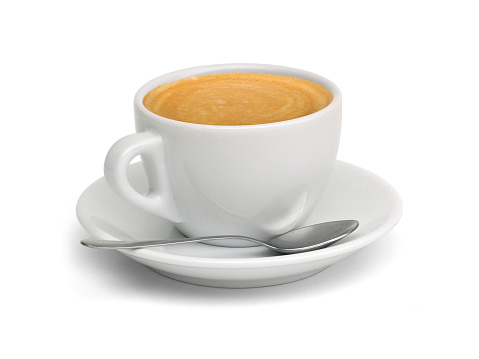 A cup of coffee with a spoon and saucer