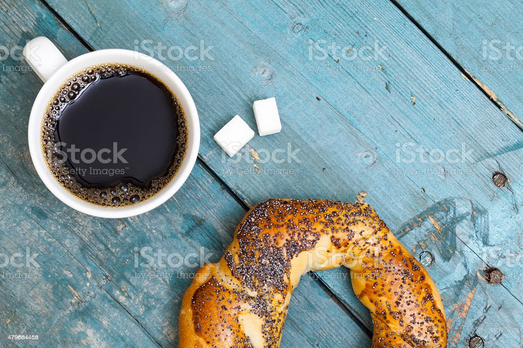 Cup of coffee with bagel top view stock photo