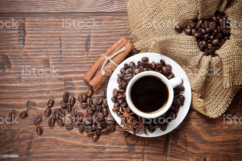 Cup of coffee with beans and spicery stock photo