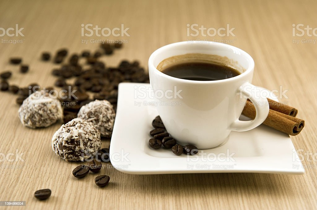 Cup of coffee with beans and truffles stock photo