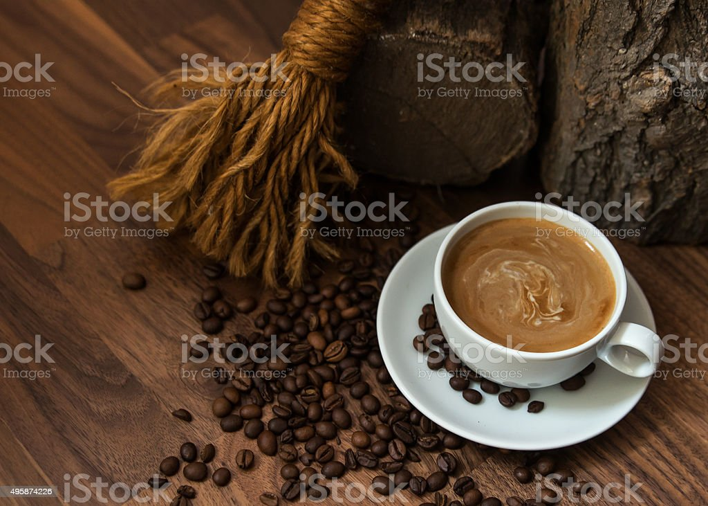 Cup of coffee with beans in earthy setting stock photo