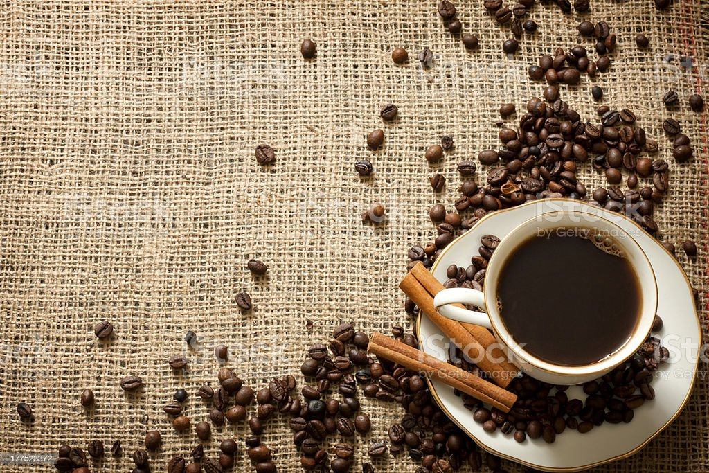 Cup of coffee with beans vintage background royalty-free stock photo