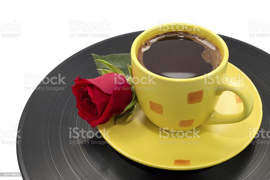 Cup of Coffee with Beautiful Red Rose on Black Record stock photo