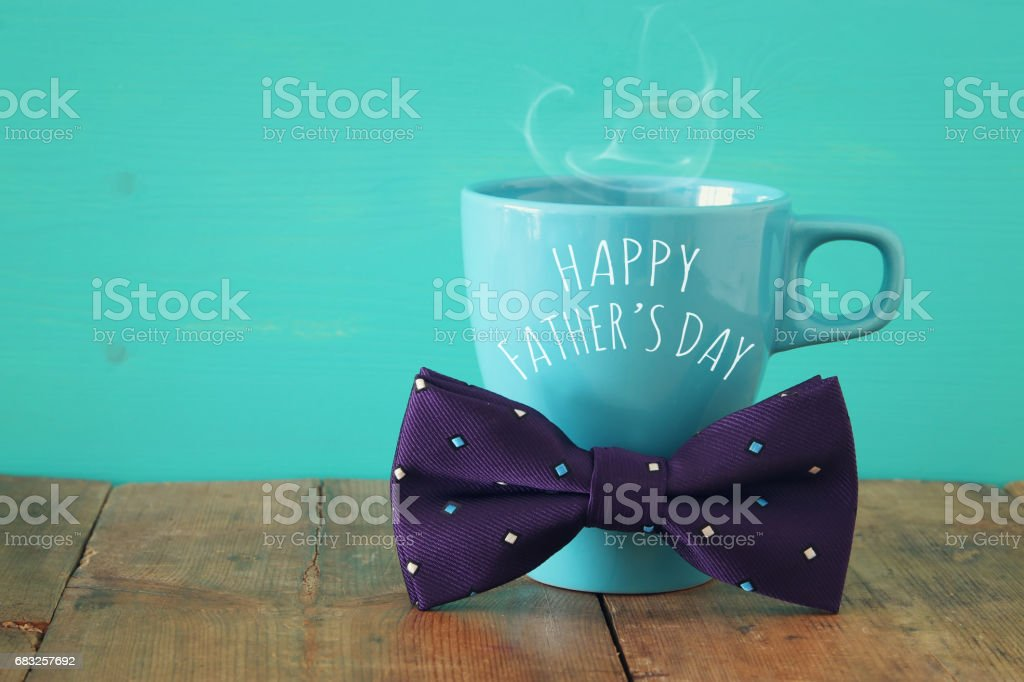 Cup of coffee with bow tie. Father's day concept foto de stock royalty-free