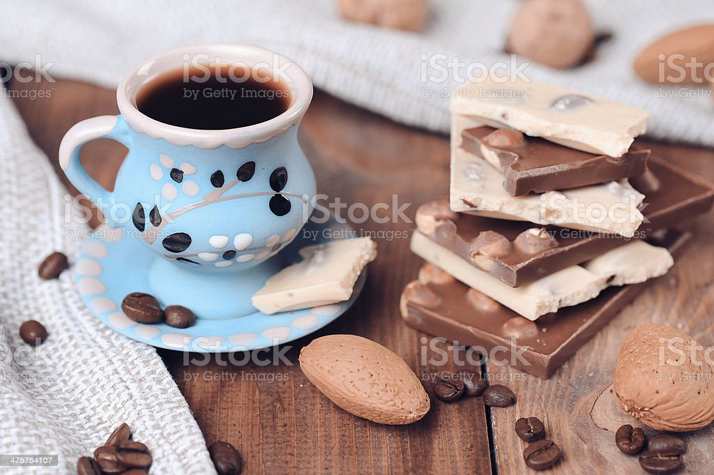 Cup of coffee with chocolate bars royalty-free stock photo