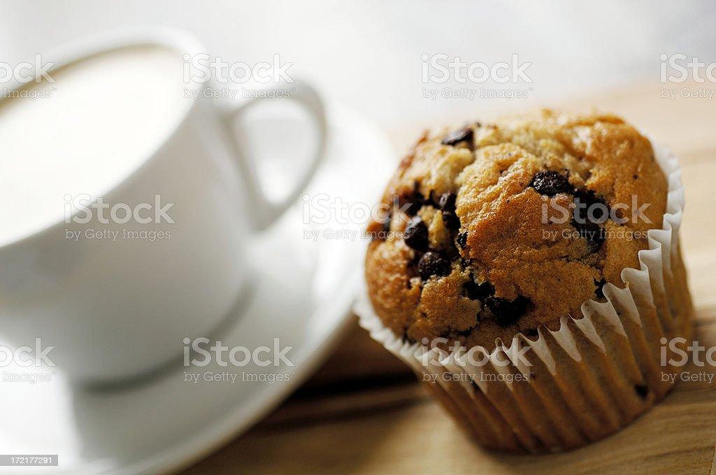 Cup of Coffee with chocolate chip muffin stock photo
