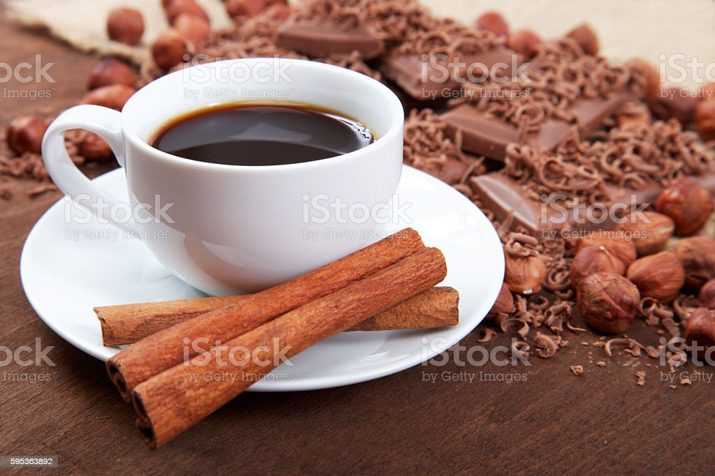 Cup of coffee with cinnamon sticks in a saucer, chocolate stock photo