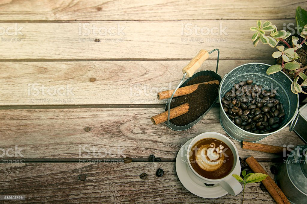 Cup of coffee with coffee bean and cinnamon royalty-free stock photo