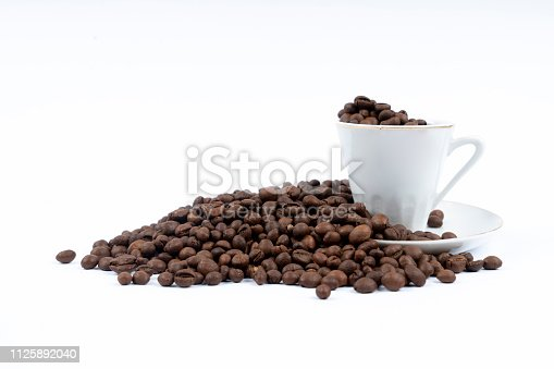 519529874 istock photo Cup of coffee with coffee beans on white background 1125892040