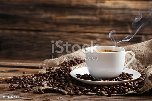 istock Cup of coffee with coffee beans 521697444