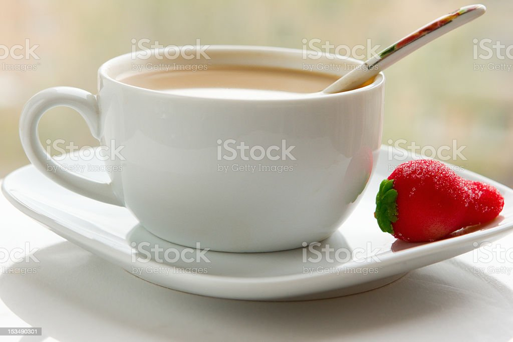 cup of coffee with cream and marzipan royalty-free stock photo