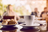 istock Cup of coffee with croissant 512752390