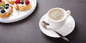 istock Cup of coffee with fruit sandwiches 670333696