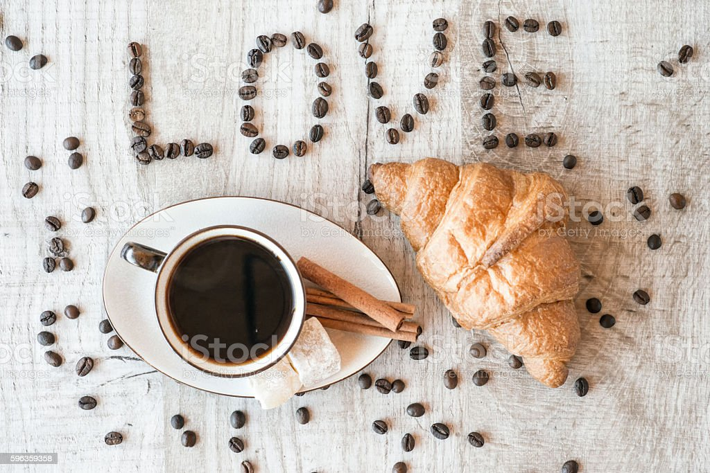 Cup of coffee with grains, croissant. title i love coffee. royalty-free stock photo