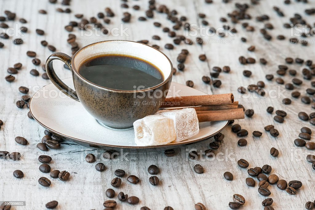 Cup of coffee with grains, delight and cinnamon royalty-free stock photo