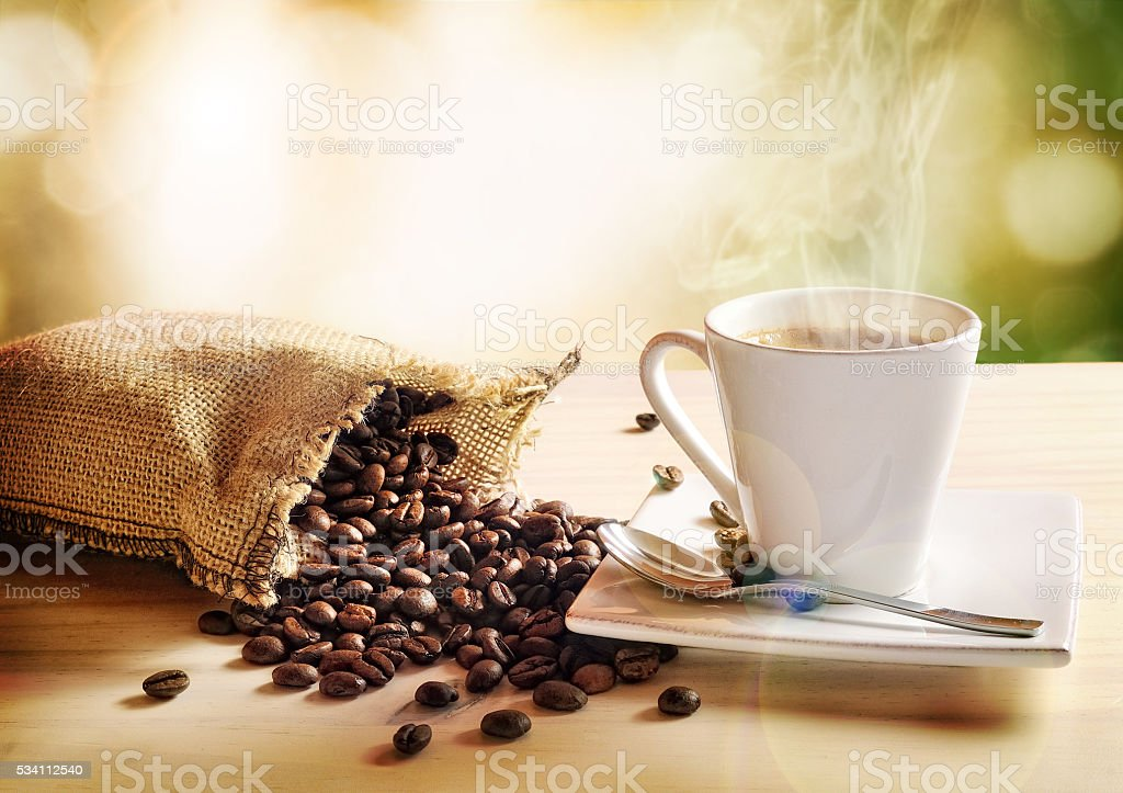 Cup of coffee with green nature background elevated view stock photo