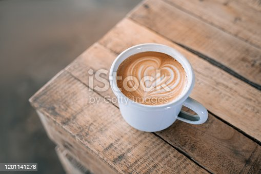 1009835562 istock photo Cup of coffee with latte art in the wooden space background. 1201141276