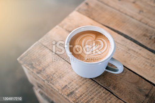 1009835562 istock photo Cup of coffee with latte art in the wooden space background. 1204517210